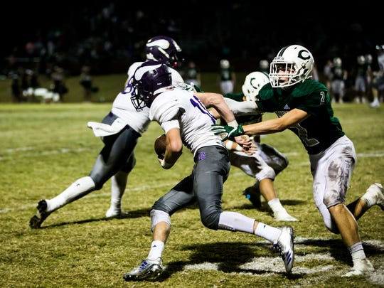 Opelousas Catholic wide Receiver Cale Cart gains yardage after a catch in the football game between the Vikings and Catholic High Point Coupee in New Roads Friday Nov. 3, 2017.