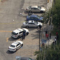Police investigate a shooting at Texas Southern University in Houston where two people were shot Friday, Oct. 9, 2015.