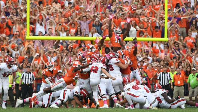 North Carolina State place kicker Kyle Bambard (92) misses a 33-yard field goal attempt wide right, sending the game into overtime on Saturday at Clemson's Memorial Stadium.