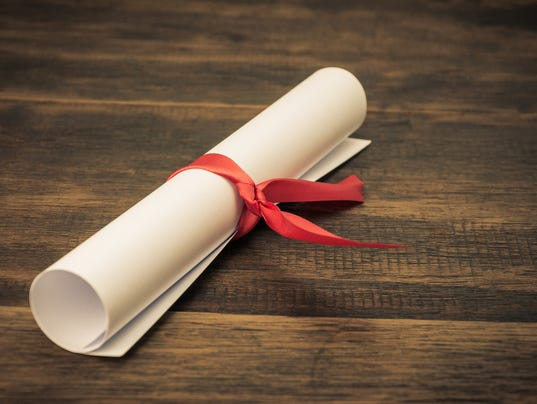 Parchment diploma scroll on wood background