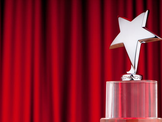 Over star award isolated on a red curtain backround