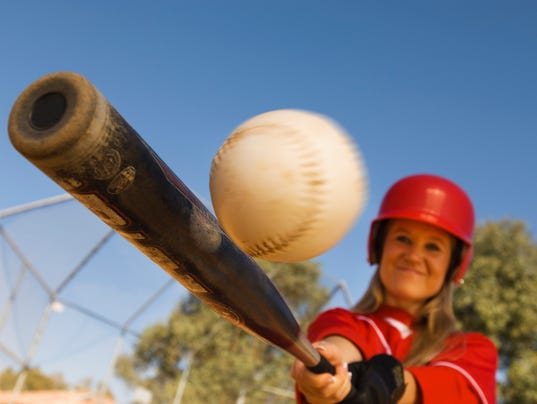 Batter Hitting Softball