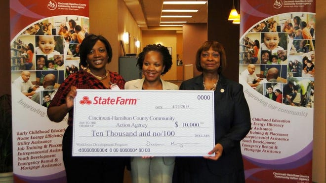 State Farm local agents Leah Brantley and Deatria Walker present a grant check to CAA president/CEO Gwen L. Robinson.