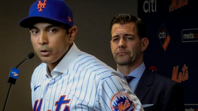 New York Mets vice president & general manager Brodie Van Wagenen, right, listens as new Mets manager Luis Rojas speaks during a news conference, Friday, Jan. 24, 2020, in New York.