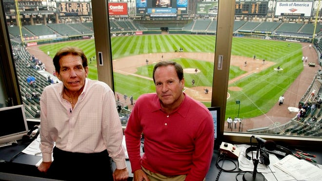 From April 28, 2008, radio broadcasters Ed Farmer, left, and Steve Stone pose in the broadcasting booth before a baseball game between the Baltimore Orioles and Chicago White Sox in Chicago. Farmer, a former All-Star reliever who spent nearly three decades as a radio broadcaster for the Chicago White Sox and became an advocate for organ donation, has died. He was 70. The White Sox said Thursday, April 2, 2020, he died the previous night in Los Angeles following complications from a previous illness.