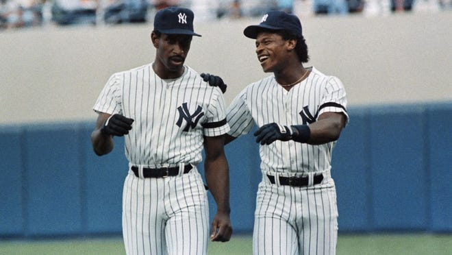 New York Yankees Rickey Henderson, right, welcomes Claudell Washington who was obtained from the Atlanta Braves with Paul Zuvella for Ken Griffey, Monday, June 30, 1986, New York. Washington started on in left field against the Detroit Tigers at Yankee Stadium.