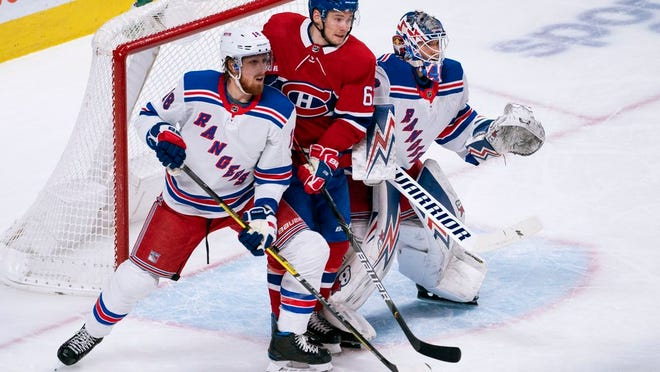 Montreal Canadiens' Artturi Lehkonen slips in between New York Rangers goaltender Alexandar Georgiev and defenseman Marc Staal during the first period of an NHL hockey game Thursday, Feb. 27, 2020, in Montreal.