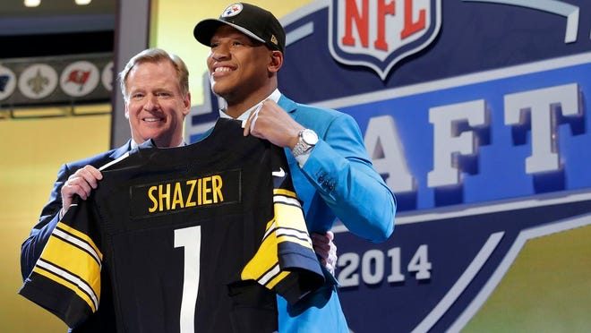 Ryan Shazier poses with NFL commissioner Roger Goodell after being selected by the Pittsburgh Steelers as the 15th pick in the first round of the 2014 NFL draft.