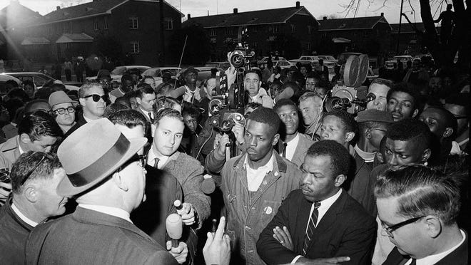 In this Feb. 23, 1965, file photo, Wilson Baker, left foreground, public safety director, warns of the dangers of night demonstrations at the start of a march in Selma, Ala. Second from right foreground, is John Lewis of the Student Non-Violent Committee. Lewis, who carried the struggle against racial discrimination from Southern battlegrounds of the 1960s to the halls of Congress, died Friday, July 17, 2020.