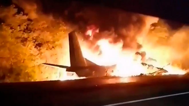 In this TV grab released by Ukraine's Emergency Situation Ministry, an AN-26 military plane bursts into flames after it crashed in the town of Chuguyiv close to Kharkiv, Ukraine, late Friday, Sept. 25, 2020. Among 28 people on board 22 people were killed.