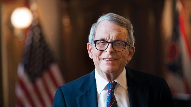 Mike DeWine, photographed in February 2020 in the governor's Statehouse office