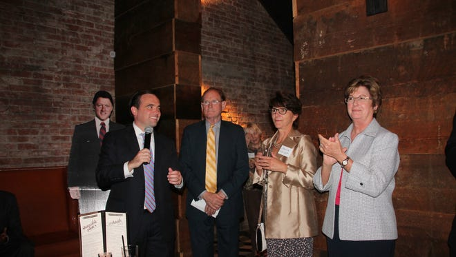 Mayor John Cranley, left, introduces former Clinton administration official Harold Ickes at Monday's Ready for Hillary event. Held at Igby's, Downtown, it was co-hosted by former Mayor Roxanne Qualls, right. Also shown is Janice Enright, Ickes' partner, and a cardboard Bill Clinton.