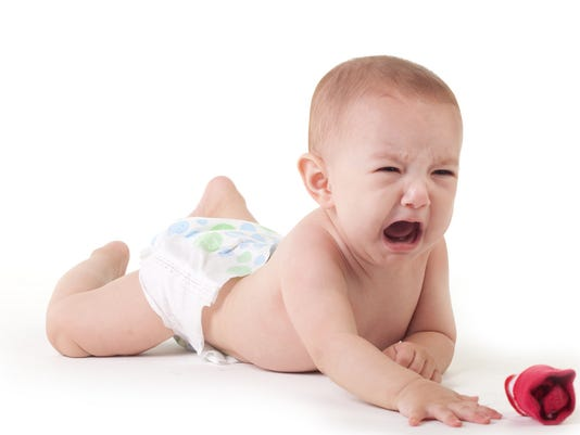 Baby crying on white
