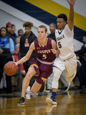 Cooper's Adam Kunkel (5) dribbles past Fairdale's Glenn Queen (5) during their game at the King of the Bluegrass in Fairdale on Thursday, Dec. 21, 2017.