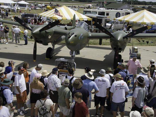 A P-38 is on display at a past Experimental Aircraft