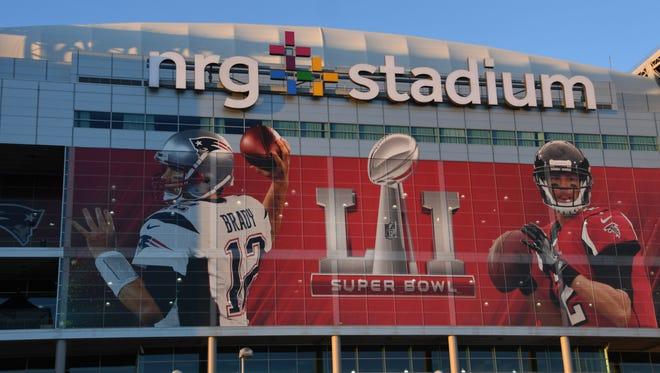 General overall view of NRG Stadium exterior with graphics of New England Patriots quarterback Tom Brady (12) and Atlanta Falcons quarterback Matt Ryan (2) prior to Super Bowl LI on Feb 5, 2017.