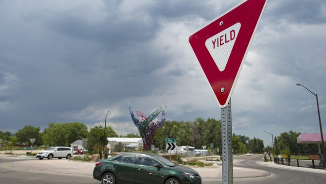 Drivers navigate a roundabout at N. Shields Street and W. Vine Drive. Crashes at Fort Collins roundabouts have a lower rate of injury than crashes at signalized intersections.