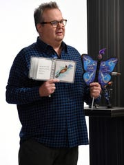 "Eric Stonestreet, host of ABC's ""Toy Box,"" meets with Michelle Lennane Gorman of Naples about her invention, the ""Butterfly Book."""