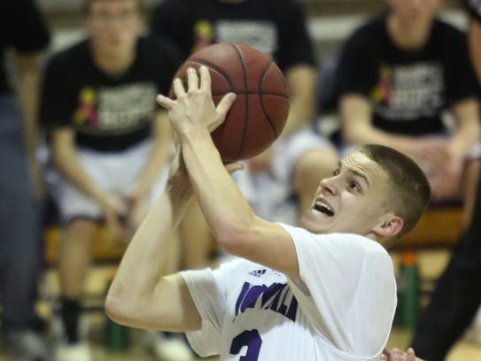 Norwalk sophomore Luke Vaske tries to get a shot away.