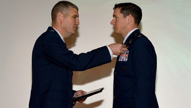 U.S. Air Force Lt. Col. Kenneth Stremmel, 315th Training Squadron commander, presents the Purple Heart medal to 2nd Lt. Daniel Hipps, 315th TRS trainee on Jan. 31, 2018.