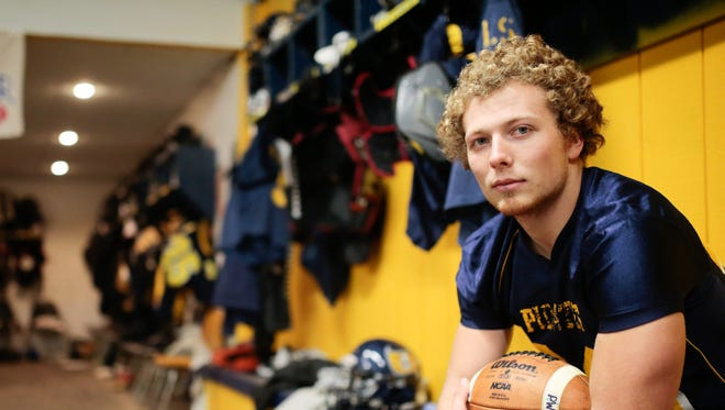 Pewamo-Westphalia High School running back Jared Smith poses for a photo after practice at Pewamo-Westphalia High School in Westphalia on Monday November 21, 2016.  Smith, who set the single-season rushing state record last year, has gained over 8,000 yards during his career.