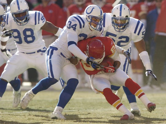 1/11/2004 -- (PHOTO BY MATT DETRICH) Colts playoff game at Kansas City, file 92520 // Colts defense, l-r, Robert Mathis, Jason Doering, and Keyon Whiteside put a stop to KC's Dante Hall in the first quarter.