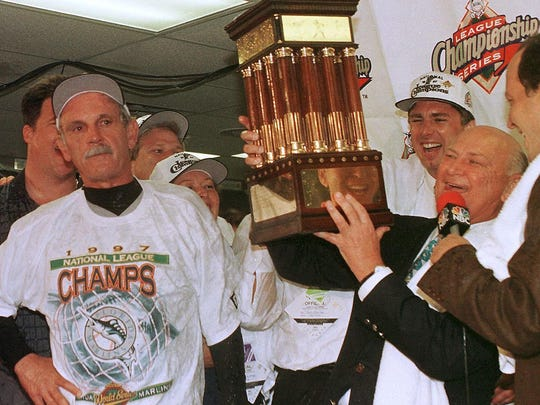 Dave Dombrowski and Jim Leyland celebrate the 1997 NLCS title with the Marlins.