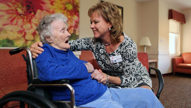 Elaine Healy, M.D., the Vice President of Medical Affairs at United Hebrew in New Rochelle, talks to her mother-in-law Lydie Cardinale, a resident of the facility, Nov. 4, 2016.