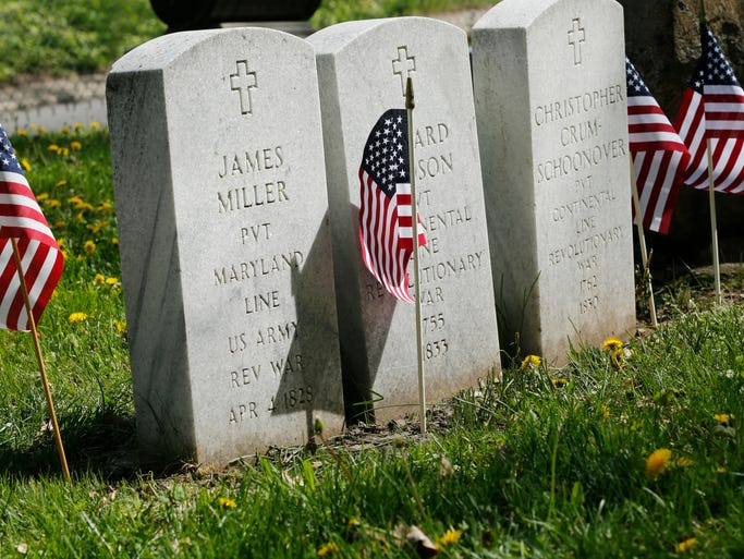 Grave marker for Pvt. James Miller, Revolutionary War veteran, as the Sons of The American Revolution and the Daughters of The American Revolution hold a memorial service honoring Miller of the Maryland Militia Saturday, May 10, 2014, in Greenbush Cemetery. Miller is among 21 Revolutionary War veterans buried in Tippecanoe County.