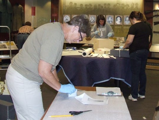 A team of curators from across the region packs artifacts
