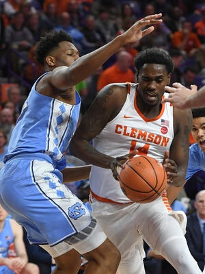 North Carolina forward Sterling Manley (21) guards Clemson forward Elijah Thomas (14) during the 1st half on Tuesday, January 30,  2018, at Clemson's Littlejohn Coliseum.