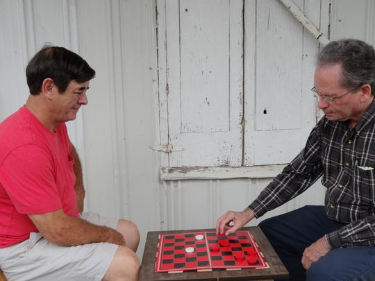 Gary Windrow, left, and Dana Lowe play a game of checkers