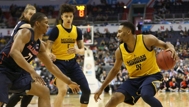Mar 9, 2017; Washington, DC, USA; Michigan Wolverines guard Zak Irvin (21) controls the ball as Illinois Fighting Illini guard Malcolm Hill (21) defends in the second half during the Big Ten Conference Tournament at Verizon Center. The Wolverines won 75-55.