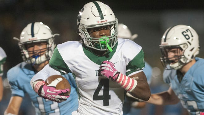 Camden Catholic's Marcus Hillman runs the ball during the 1st quarter of Friday night's football game between Camden Catholic and Shawnee played at Shawnee High School.  10.13.17