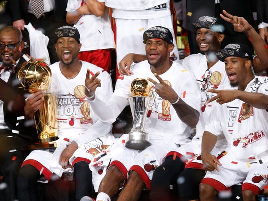 Dwyane Wade, LeBron James and Chris Bosh celebrate