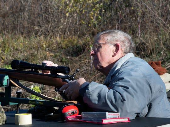 Joe Bernat, of Springettsbury Township, practices at the shooting range days before rifle deer season opens.