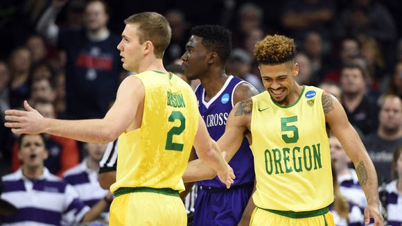 March 18, 2016; Spokane , WA, USA; Oregon Ducks guard Casey Benson (2) and guard Tyler Dorsey (5) celebrates a scoring play against Holy Cross Crusaders in the first round of the 2016 NCAA Tournament during the first half at Spokane Veterans Memorial Arena. Mandatory Credit: Kyle Terada-USA TODAY Sports