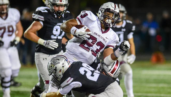 Dowling's Jacob Zachary (23) gets tackled by Ankeny Centennial's Garrett Nichols (29) on Friday, Oct. 14, 2016, during a football game between the Dowling Maroons and the Ankeny Centennial Jaguars at Ankeny Stadium.