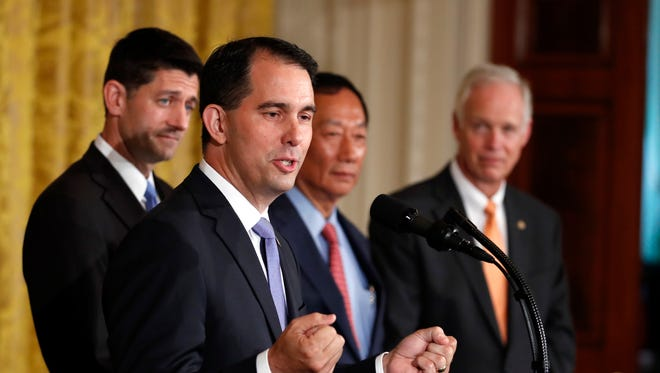Wisconsin Gov. Scott Walker speaks in the East Room accompanied by House Speaker Paul Ryan of Wisconsin, Foxconn CEO and founder Terry Gou and Sen. Ron Johnson (R-Wis.) at the White House in Washington, Wednesday.