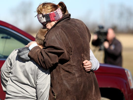 Karen Axmacher hugs her grandsons Justin Smith, 11 years old, left, and Jordon Smith 15, years old (not seen) after a 14-year-old, student shot two other male teen students in the cafeteria of Madison Jr/Sr High School in Madison Township, Monday February 29, 2016. James Austin Hancock has been charged with two counts of attempted murder, two counts of felonious assault, one count of inducing panic and making terrorist threats.