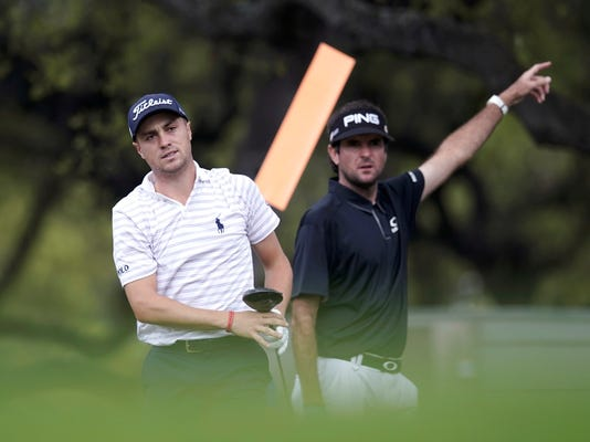 Justin Thomas, left, reacts to his drive from the eighth tee as opponent Bubba Watson, right, signals the ball direction during round six at the Dell Technologies Match Play golf tournament, Sunday, March 25, 2018, in Austin, Texas. (AP Photo/Eric Gay)