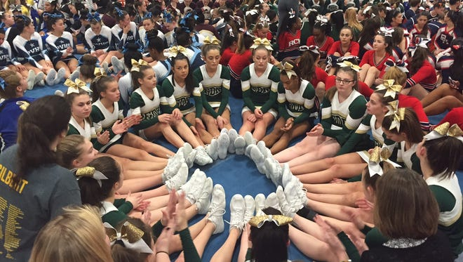 The Franklin D. Roosevelt cheerleading team sat in a circle awaiting the results of the John Jay Cheer Invitational on Saturday.