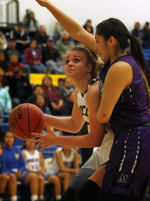 Bloomfields' Halle Payne attempts a shot against Miyamura on Thursday, Feb. 22, 018 at Bobcat Gym in Bloomfield.