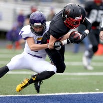 Santiam Christian's Riley Roberts scores a touchdown in the 2014 state semifinals.