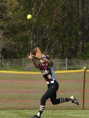 Arlington's Cori Piazza makes a running catch in center field during Monday's game against Ketcham.