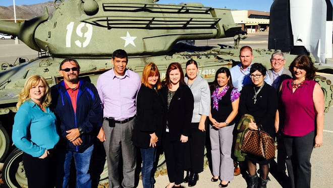 Participants and organizers of the inaugural Leadership Fort Bliss class appear before the static display of equipment at the Fort Bliss museum complex.