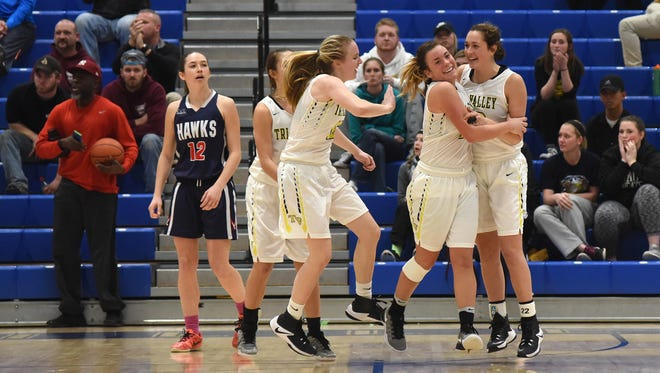 Tri-Valley celebrates after clinching Tuesday night's regional semifinal win over Bishop Hartley at Zanesville High School.