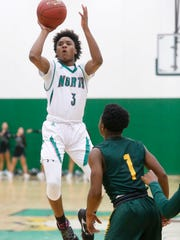 North sophomore Tyreke Locure (3) takes a shot over Hoover sophomore Kenny Quinn (1) Friday, Jan. 6, 2017 during their game at North High School in Des Moines