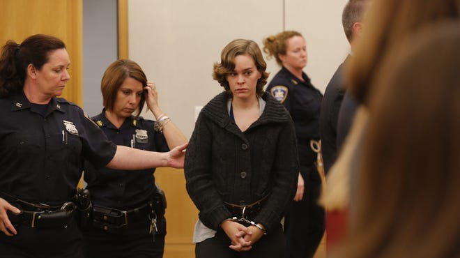 Lacey Spears, 26, enters state Supreme Court on Tuesday, to be arraigned on murder and manslaughter charges in the death of her five-year-old son, Garnett. She pleaded not guilty and Judge Barry Warhit ordered her held without bail.