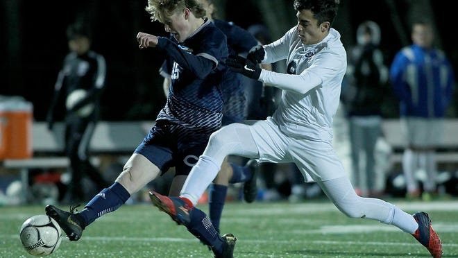 Cohasset's Whit Swartwood tries to get a shot off while being defended by Atlantis Charter's Miguel Viana-Almedia during second-half action of the Division 4 South final at Holbrook High on Saturday, Nov. 16, 2019.